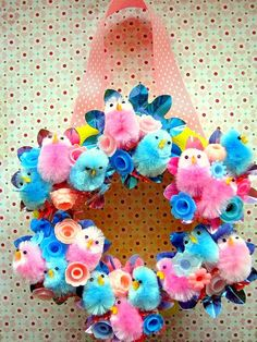 Cute vintage style Easter Wreath.... they used birthday candle holders... so unique and colorful!