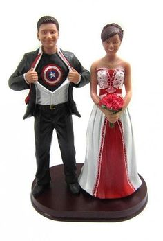 Captain America wedding cake topper sculpted to look like the bride and groom