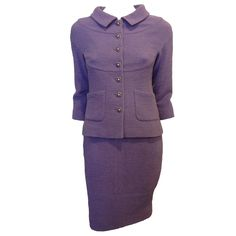 Chanel Lavender Tweed Suit with Purple Buttons | From a collection of rare vintage suits, outfits and ensembles at https://www.1stdibs.com/fashion/clothing/suits-outfits-ensembles/