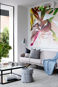I love the light neutral pallet with the giant splash of colour on the wall.
