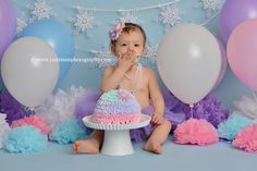 Blog of Recent Sessions by 11 Sixteen Photography | 11 Sixteen Photography pastel winter wonderland onederland snowflake pink purple blue light colors tutu headband cake smash photographer first birthday baby