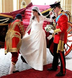 I love that Prince William is holding her flowers here!