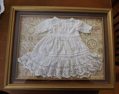 "Antique Doll Dress Presented in Shadow Box Frame Nice Decorative Piece 9"" X 12"""