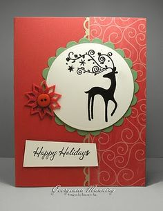 handmade Christmas card ... red and white ... silhouette deer with flourish antlers in a layered circle ,,,, simple card with a slightly mod feel from the wonky shaped sentiment block ... like it!!