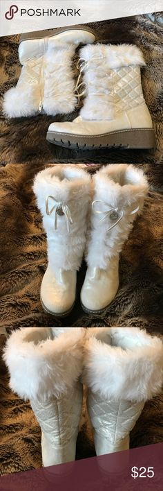 Juicy Couture White Faux Fur Boots Adorable used Juicy Couture boots with white faux fur. Lightly used with some wear on toes (shown in picture). Zipper on side with faux laces. Sparkles all over body of boot. These boots run BIG wear with boot socks! Size equivalent to a women's 6.5. Winter perfect ❄️ Juicy Couture Shoes Boots