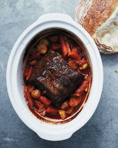 Classic Pot Roast for the Slow Cooker   Martha Stewart Living - For pot roast -- a tough cut of beef braised until succulent and tender -- we start with a well-marbled chuck.