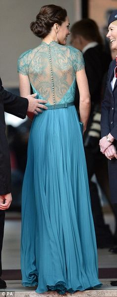 Kate Middleton - teal-coloured sweeping Jenny Packham dress which had delicate lace at the shoulders and back, with an unusually plunging neckline.
