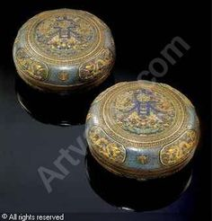 Qianlong Period, 1736-1796 (China) A rare pair of gilt-bronze, cloisonne enamel and champleve boxes