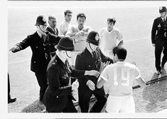 West Germany 4 v Uruguay 0. Referee Jim Finney calls for police assistance after Hector Silva refuses to leave the pitch after being ordered off for a foul on Germany's Helmut Haller. 23rd July 1966 1966 World Cup, Referee, Fifa, Modern Frames, Pitch, Germany, Memories, Couple Photos, Prints