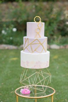 Fondant geometric watercolor cake by Frost It Cakery. Photo by Krista Mason