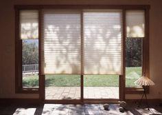 Pleated blinds on sliding glass doors
