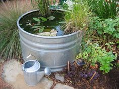 If you long for a backyard pond but just don't have room, create one in a cattle trough. At three feet in diameter, this pond is home to a dwarf water lily, assorted pond plants, and even a few goldfish. Container Pond, Container Water Gardens, Container Gardening, Small Backyard Gardens, Ponds Backyard, Backyard Landscaping, Garden Ponds, Patio Pond, Gravel Patio