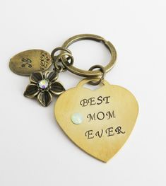 Hand stamped personalized keychain for mom. Personalized Gifts For Mom, Handmade Gifts, Gemstone Jewelry, Unique Jewelry, Jewelry Accessories, Handmade Jewelry, Needle Case, Unique Gifts For Her, Inexpensive Gift