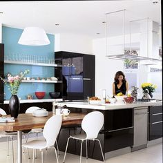 kitchen aqua backsplash- painted covered with clear glass - No tile!