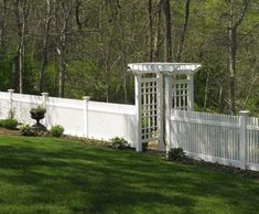"4ft Chestnut Hill with Arbor - An impressive expanse of 4' high Chestnut Hill hollow vinyl fence with Quabbin caps is highlighted by our magestic 42"" wide Groton garden arbor."