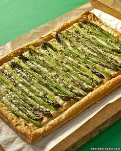 Asparagus on puffed pastry - I will try this with cream cheese, bacon bits and Pillsbury dough.  We LOVE asparagus!