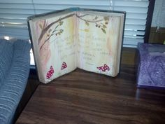 An old book glued opened and decorated