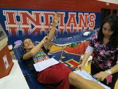 Senior athlete Luke Karn donates for the first time. — with luke karn at Piqua High School.