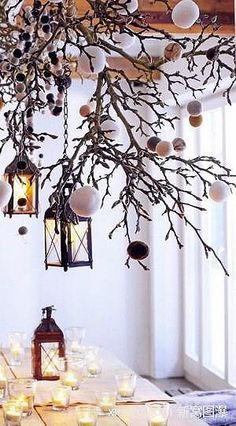 Christmas - branch across top of booth with hanging ornaments, battery operated lights