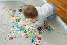I love the look of of mini hexagons and this I Spy quilt by Ellison Lane is adorable!