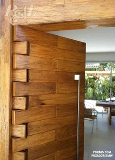 Amazing wooden hinged door