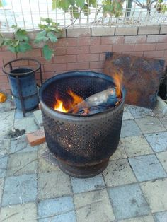 Repurpose a Washing Machine Drum into a Fire Pit I think the tyre rim looks neat as a base.