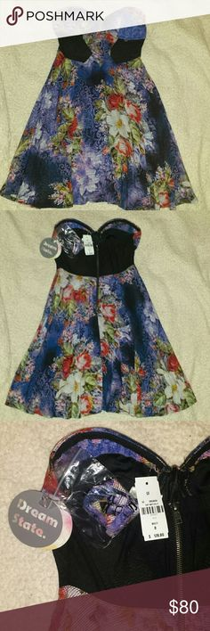 NWT Dream State Vivaldi Dress LF This size 8 dress fits more like a size 6. It has a sweetheart neckline, removable straps (in the plastic bag seen in photo), black mesh panels over the ribcage and upper back and a fully lined skirt. The zipper works perfectly and the cups are lightly padded. Dream State Dresses Mini