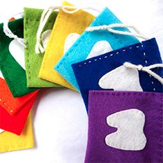 Make a felt tooth fairy bag with a strip of felt and some simple stitching. Each bag has a tooth shaped pocket to hold the lost baby tooth.