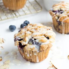 A standard coffee cake muffin with added fresh blueberries and topped with an almond crumble and sweet glaze.