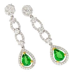 These 18k white gold H.Emperor earrings features a 1.10ctw tsavorite pears accented by 1ctw diamond rounds. These earrings weighs approximately 5.4 grams.
