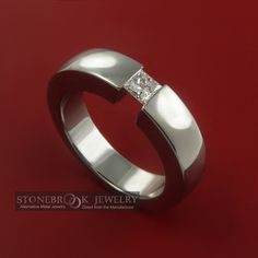 Love tension set princess cut gems in titanium. Lab sapphire in a pastel color would be good...