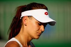 Agnieszka Radwanska Photos - Agnieszka Radwanska of Poland shows her dejection against Saisai Zheng of China in their first round match on Day 1 of the Rio 2016 Olympic Games at the Olympic Tennis Centre on August 6, 2016 in Rio de Janeiro, Brazil. - Tennis - Olympics: Day 1