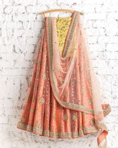 How pretty is this coral yellow lehenga by Swati Manish #Frugal2Fab