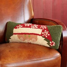 Who has your back? Santa does. Celebrate it with a hand-hooked wool pillow featuring the merry man himself. The pillow has a hidden zipper closure and...