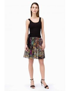 Geometrical Printed Skirt  http://www.fuzzishop.com/en/skirts/36-geometrical-printed-skirt.html  Printed tulle short wrap over skirt, with a waist sash closure. Made in Italy  FREE SHIPPING AND FREE RETURNS. FOR FASHION LOVERS