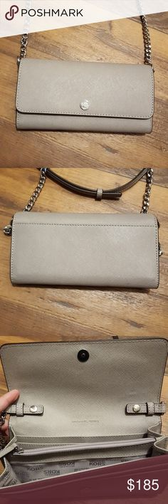 Michael Kors jet set travel crossbody This is Barely Used and can be used just as a clutch or as a crossbody with adjustable straps ✔price firm 🚫no trades Dimensions are 8 inches x 4.5  Can easily fit my phone and keys Michael Kors Bags Crossbody Bags