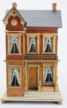 German, circa late 1800's, lithographed paper on wood front opening two room dolls' house; interior retains nice original papers.