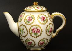 A Sevres Porcelain Teapot and Cover. Decorated with Roses within Gilt Leaved Roundels. For a Sevres Cup and Saucer of this Pattern Painted by Noel (Dated 1773) in the Hermitage Museum Russia See : La Porcelaine de Sevres du XVIII, Catalogue de la Collection (Nina Birioukova, Natalia Kazakevitch, Edition du Musee de l'Ermitage,2005. In Russian Only) Page 336 Item 1204.