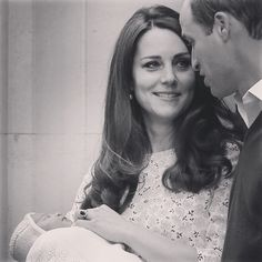 Kate looks lovingly at William as they introduce the new Princess to the media.