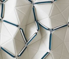 Innovative Textiles design - interlocking geometric fabric with irregular 3D pattern; fabric manipulation // Kvadrat