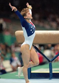 Kerri Strug  Atlanta Olympics  |  July 23, 1996  |  Kerri Strug holds her pose after sticking the landing on her vault despite a painful ankle injury suffered on her first attempt. The United States' gold medal hopes rested on her, and she fought the pain on her second attempt to secure the title for the U.S.