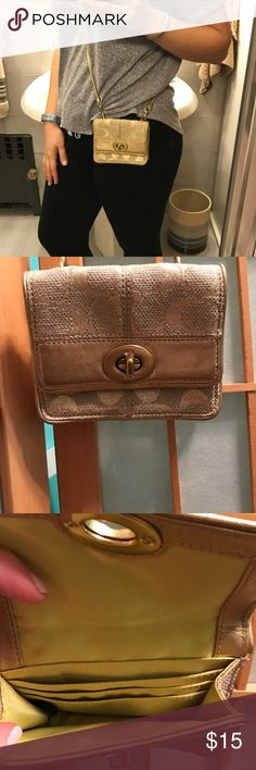 Women's Coach Cross Body or Shoulder Bag Women's Coach Cross Body or Shoulder Bag, Gold and Beige, Turn Lock Closure, Outside Slip Pocket, Card Slots Inside, Original Tag Included, About 4 1/2 Inches Long Going Across and 3 Inches Deep, Its a Small Bag for Little Things like Credit Cards/Cash/Id, a LipStick, etc. May not be Big Enough for Phone, I Cant Fit My iPhone Inside Coach Bags Crossbody Bags
