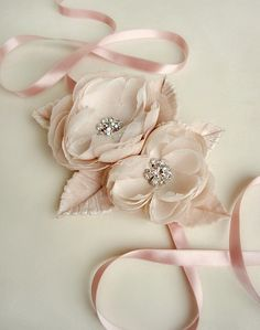 These flowers start out as two different kinds of silk chiffon that is hand dyed to reach the perfect shade of blush. Then finally the chiffon can be put through the steps to be made into these beautiful blooms for you. Paired with handmade, hand dyed silk velvet leaves and placed onto a satin ribbon. Perfect as a simple hairband.