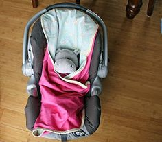 car seat blanket.  It has holes to put the harness straps through, then strap the baby in and cover him up.  Of  course, I won't be doing it in pink:)