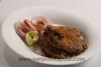Masaledar Machchli : Shallow fried rawas fish coated in a mixture of spices.