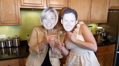guests pose with cut out faces of the Bride & Groom at a wedding shower