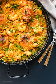 Chicken Thighs and Shrimp Paella Recipe by Love Keil -- www.munchkintime.com #paellarecipe