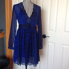 Michael Kors leopard print long sleeved dress Michael Kors mini dress in bright blue and black print. Sheer material and lined. Brand new without tags. Michael Kors Dresses Mini