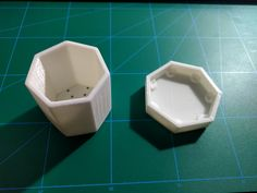 The heptagonal planter and the tray side by side
