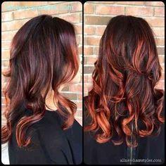 Dark brown hair with burgundy highlights
